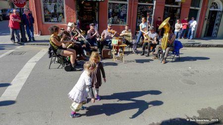 Street musicians and little kids dancing, Bourbon Street, French Quarter