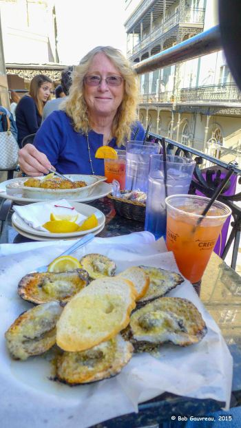 'Oysters Royal House', Hurricanes and stuffed mushrooms, on the second story street balcony, Royal House, in the French Quarter, New Orleans, Louisiana