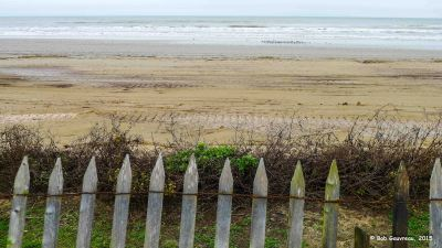 Fence, washed out beach and surf, Dellenera RV Park, Galveston Island, Texas