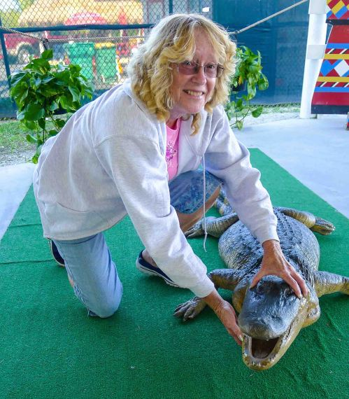 Dee Dee, ' gator wrestling in the Everglades, Florida.