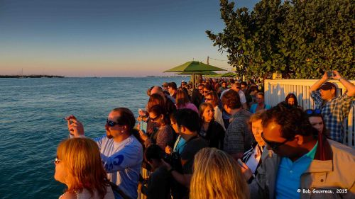 Tourist waiting for sunset, an evening ritual in Key West.  We don't know any of these people.