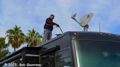 Michael, from Red Rock RV Washers, pressure washing our roof